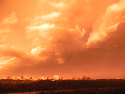 Yesterday mornings storm from my balcony. Edmonton's creamsicle skies woke me up at 5:40AM and I couldn't be happier that I got to witness such a great storm from such a great perch! I did not edit this photo at all.