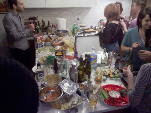 tons of food at friendsgiving party! i made the world's best turkey and it turned out incredible!