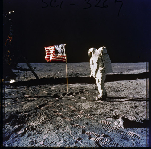 "First moon walk.  July 20, 1969.  Photo of Astronaut Edwin E.  ""Buzz"" Aldrin on the surface of the moon, next to the U.S. flag.  Photographed by Neil Armstrong, first person to set foot on the moon.  Apollo 11 mission. -via The National Archives, Nixon Administration"