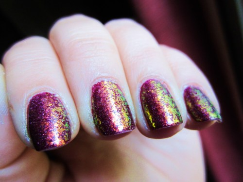 "OPI ""Extravagance"" with Sally Hansen ""Hidden Treasure""!  I painted my nails with the OPI a few days ago and kept thinking that it was pretty, but I wasn't feeling it.  So I searched thru my stash and decided to pair it with Hidden Treasure.  I love the deep magenta with shimmers of orange, yellow and green! Its like my nails are on shiney fire"