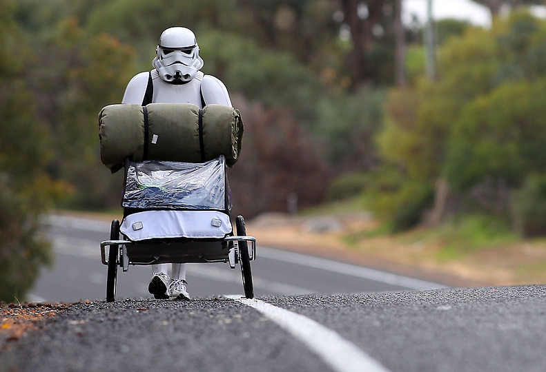 A Real Trooper Stormtrooper Paul French is on a journey of over 4,000 kilometre from Perth to Sydney talking with a young Star Wars fan at Port Bouvard bridge on July 15, 2011 in Perth, Australia. French aims to walk 35-40 kilometres a day, 5 days a week, in full Stormtrooper costume until he reaches Sydney. French is walking to raise money for the Starlight Foundation – an organisation that aims to brighten the lives of ill and hostpitalised children in Australia. denverpost.com