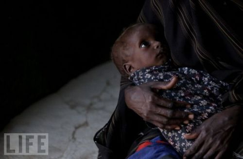 life:  In late July 2011, the United Nations declared the ongoing famine the worst in 20 years. Some 11.5 million people have been affected by drought in the region, but the 270-percent inflation rate in Somalia has made it financially impossible for companies to import food and make a profit. Two regions of southern Somalia especially hard can claim a malnutrition rate of 50 percent, with 10,000 dying each day of hunger. And the famine's effects have spread to neighboring countries. In Dadaab, Kenya, a refugee camp meant for up to 90,000 Somalis fleeing the famine has growing into the largest refugee camp in the world, at four times that population. see more — Famine in Somalia