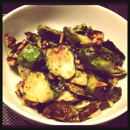 I have a new-found love for brussels sprouts. Weird, I know. I think it was boredom with my usual broccoli-cauliflower-asparagus rotation coupled with a life changing dish I recently had at Ardeo (crispy brussels sprouts with pistachios, apricots and yogurt) that did it. In any case, thought I'd share a particularly-delicious recipe I found on Closet Cooking. The tang of the apple cider vinegar with the sweetness of the maple syrup and spiciness of the mustard makes for an amazing blend of flavors!  Maple Dijon Roasted Brussels Sprouts Ingredients: 2 pounds brussels sprouts (trimmed and halved) 1 tablespoon olive oil salt and pepper to taste 1 tablespoon olive oil 1 tablespoon apple cider vinegar 1 tablespoon maple syrup 1 teaspoon dijon mustard 1 tablespoon grainy mustard 1 small clove garlic (grated) salt and pepper to taste 1/4 cup almond slices (toasted) Directions: Preheat the oven to 400°F. Toss the brussels sprouts in the oil along with the salt and pepper. Arrange the brussels sprouts in a single layer on a baking sheet. Bake the brussels sprouts for 30 minutes, be sure to flip them half way through. Whisk together the oil, vinegar, maple syrup, mustards, garlic, salt and pepper in a small bowl. Toss the brussels sprouts and almonds in the maple dijon vinaigrette. Makes 4 servings.