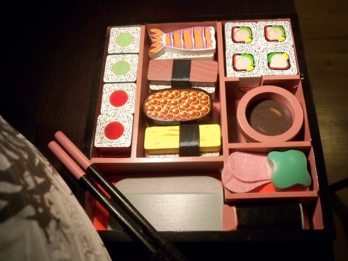 this is my toy sushi set, given to me by my boyfriend who clearly knows me too well. the chopsticks are velcro, and you can stick all the pieces together into a roll and then use the knife to cut them up! keeps me entertained longer than it should. took this picture while waiting for my actual sushi to arrive!