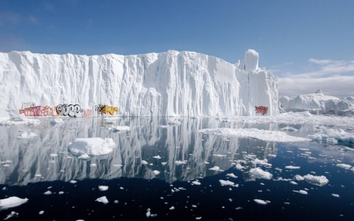 Graffiti on polar icebergs. This is a really interesting combination of man and nature.