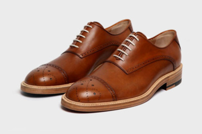 "Band of Outsider Classic Wingtip Oxfords ""Band Of Outsiders have channelled their 50s American preppy aesthetic to create the perfect Oxford shoe. From the weight, shape and smell of this classic Oxford you can clearly tell that it is the work of a craftsman. The rich tan leather is contrasted by cream laces, while detail is provided by the elegant wingtip pattern on the toe.  A playful touch is introduced via stamped lettering on the footbed, which reads 'this is a Band Of Outsiders shoe'. Finally, to prevent confusion, Band Of Outsiders have helpfully labelled each shoe with 'left' and 'right', which is stamped on the sole. And if you're not a man of letters, the colour of the shoe soles differ – with red for the right and blue for the left. """