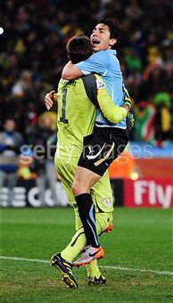fuciiyeah:  Uruguay: celebration Fernando Muslera (goalkeeper) and Jorge Fucile (player) Love sports. What a beautiful sight