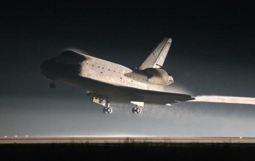 fuckyeahspaceexploration:  planetpic:  Space Shuttle Atlantis lands at Kennedy Space Center July 21, 2011 in Cape Canaveral, Florida. Atlantis was the shuttle final mission for NASA, ending the 30 years of the shuttle program.  (Joe Raedle/Getty Images)  A sad day.
