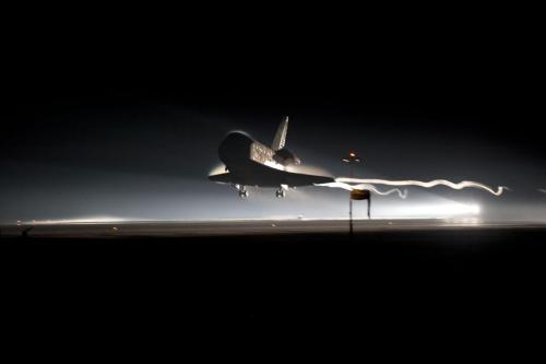 "The end of an era: Space shuttle Atlantis zoomed back to Earth today, marking the end of the 30-year program. ""Time to make our mamas proud,"" flight director Tony Ceccacci told his team in Houston's Mission Control. ""Coming home, folks."""