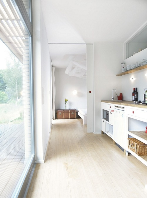 Love the simplicity of white and wood with a dash of colour. micasaessucasa:  (via Prefab Nest Complements Nature at Affordable Price | The Beautifulist)