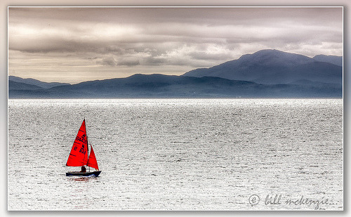 A sailboat in the water off of Lismore Island, Scotland (by Bill McKenzie / bmphoto)