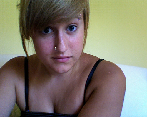 Good morning bloggers. This is a picture of me with no makeup. I just want everyone to remember we were born with imperfections and we do have flaws. As you can see mine I have a problem with my acne, and white little dots below my chin are sun spots from me being allergic to the sun. You can also see the color difference between my shoulder and my face. And yes that is a little pouch of fat from my boobs under my bra strap. This summer is making me realize I need to be more comfortable with who I am and the cards I'm delt than sitting and hating myself for something I can't change. If you knew my personality you would not expect me to have 14 holes in my body and four tattoos. My nose ring is my favorite to wear because people expect me to be a little reserved kinda person. Just by looking at me you wouldn't know I have a physical daily struggle with my body. I am in chronic pain from my bladder from a condition called painful bladder. This basically means that all of my organs are starting to lose the muscles around them and are dropping to my pelvic floor. You also wouldn't guess that I have fibromyalgia. My brain is sending too many signals to my muscles and causes chronic pain in my joins and my muscles. I have scars from depression on my arm I can't hide, and scars from my surgeries I will always have. I am me. I'm not perfect. I'm battling with my own body and mind. I lose hope and want to give up, but I would be letting the disease and society win. And by god I'm not going to let that happen.  Love Always, Even on my weakest days, I get a little bit stronger.