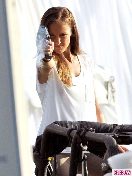 Minka's got a gun! The sexy star proved she's one tough cookie while filming for her new TV series, a remake of the beloved show Charlie's Angels. See more photos here.