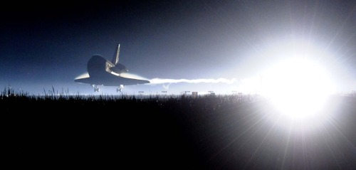 Space Shuttle Atlantis lands at the Kennedy Space Center at Cape Canaveral, Fla. Thursday, July 21, 2011. The landing of Atlantis marks the end of NASA's 30 year space shuttle program. (AP Photo/Florida Today, Craig Rubadoux)