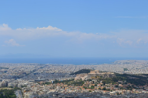 Last Day in Athens Sunday we found our way to Mt. Lycabettus. This mountain just sticks up in the middle of the city. We took a train at Tybeatus to the top and had an amazing view of all of Athens. You can see the water, the Acropolis and all the way around. It really put the city into a good perspective. When we went back to the bottom, Nellie and I went shopping in a great market. There were many shops that sold clothes, hand-made leather sandals and souvenirs. Out of no where is started to thunderstorm!! Apparently it never rains in Athens, but decided to our last day when we wanted to go shopping in an outdoor market. But this was a good thing because we happened upon a small shop in the back ally where the dresses caught my eye. We walked in and found ourselves in a women's studio where she makes all her own clothes. Nellie and I tried a bunch of clothes on and I bought a shirt and Nellie got a dress. She even put elastic in the dress for Nellie right there. Now we have one of a kind clothes from Yota in Athens. We also stumbled upon a Starbucks!! A quick and much need comfort of the States. For lunch, I finally got a gyro!! So good!!! We then met up with the boys and found our way on the metro to the airport where we flew back to Rome.