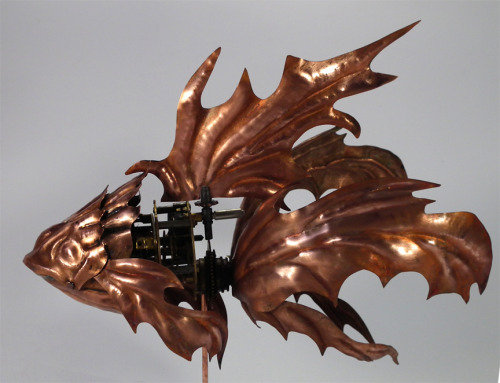"Very beautiful Steampunk fish, made with copper and antique clock parts. The fins and head have been hand cut and it stands at 10"" long. The designer/artisan is Alisha from the UK. She sells (mostly masques) from her Etsy shop."