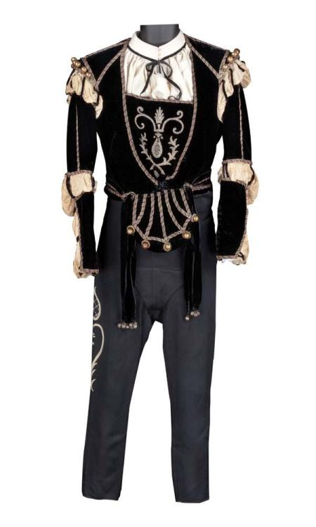 "Leslie Howard ""Romeo Montague"" black velvet doublet and pants from Romeo and Juliet. (MGM, 1936) Black silk velvet period doublet with heavy gold bullion embroidery and brass embellishments. No label. Black wool pants with embroidery on sides and suspenders. Western Costume label handwritten ""Leslie Howard 29 ½ stamped 10617"" and Western Costume white stamp. Ivory silk dickie with black ribbon. Worn by Leslie Howard as ""Romeo"" when he first meets Juliet at the masquerade ball, falls in love with her and appears at her balcony in Romeo and Juliet.  God Bless Debbie Reynold and her auction."
