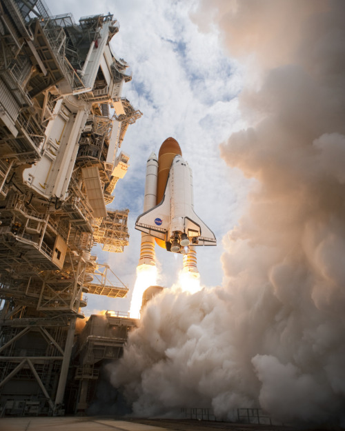 STS135-S-103 (8 July 2011) —- Space shuttle Atlantis and its  four-member STS-135 crew head toward Earth orbit and rendezvous with the  International Space Station. Liftoff was at 11:29 a.m. (EDT) on July 8,  2011 from Launch Pad 39A at NASA's Kennedy Space Center. Onboard are  NASA astronauts Chris Ferguson, commander; Doug Hurley, pilot; Sandy  Magnus and Rex Walheim, both mission specialists. STS-135 will deliver  the Raffaello multi-purpose logistics module packed with supplies and  spare parts for the space station. Atlantis also carries the Robotic  Refueling Mission experiment that will investigate the potential for  robotically refueling existing satellites in orbit. In addition,  Atlantis will return with a failed ammonia pump module to help NASA  better understand the failure mechanism and improve pump designs for  future systems. STS-135 will be the 33rd flight of Atlantis, the 37th  shuttle mission to the space station, and the 135th and final mission of  NASA's Space Shuttle Program. Photo credit: NASA