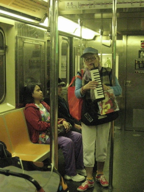 I encountered this woman on the subway my first month in New York.  inthemisosoup:  you know how there's people of walmart… here's people of the MTA…