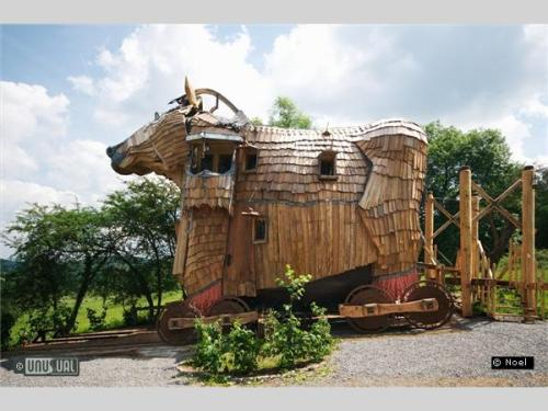 La Balade des Gnomes is a fantastical Belgian b&b designed and built by architect and hotelier Mr Noël in Belgium. The rooms are located in a farmhouse, with a Trojan Horse suite nearby. You'll need to lower the drawbridge to gain access to that horse. Sleep in a boat floating in a pool with the stars above—on the third foor of the farmhouse. Or in a wine cellar with vines, barrels and wine press furniture. Or on a spaceship in a lunar landscape. My personal favorite is the trolls habitat, with a goldfish filled stream running through.  (via La Balade des Gnomes)