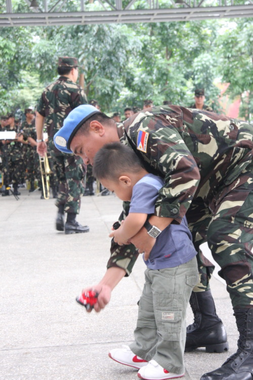 Soldier plays with son after Peacekeeping Duty from Golan Heights.