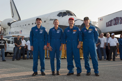 STS135-S-214 (21 July 2011) —- The final four astronauts of NASA's  Space Shuttle Program stand proudly in front of space shuttle Atlantis,  the remarkable spacecraft that took them on the STS-135 mission to the  International Space Station. From right, are NASA astronauts Chris  Ferguson, commander; Doug Hurley, pilot; Sandy Magnus and Rex Walheim,  both mission specialists. The crew returned to Earth on the Shuttle  Landing Facility's Runway 15 at NASA's Kennedy Space Center in Florida  at 5:57 a.m. (EDT) on July 21, 2011. Atlantis' final return from space  completed a 13-day, 5.2-million-mile journey to the International Space  Station. STS-135 delivered spare parts, equipment and supplies in the  Raffaello multi-purpose logistics module that will sustain station  operations for the next year. STS-135 was the 33rd and final flight for  Atlantis, which has spent 307 days in space, orbited Earth 4,848 times  and traveled 125,935,769 miles.  The Final Four. Respect.