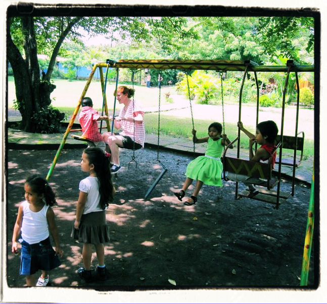 Playing on swings in Nicaragua.