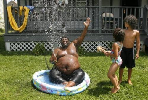 Lamon Rogers, in his Grand Rapids backyard, becomes our official summer buddha. Excellent heat gallery here. Photo by Rex Larsen (AP)