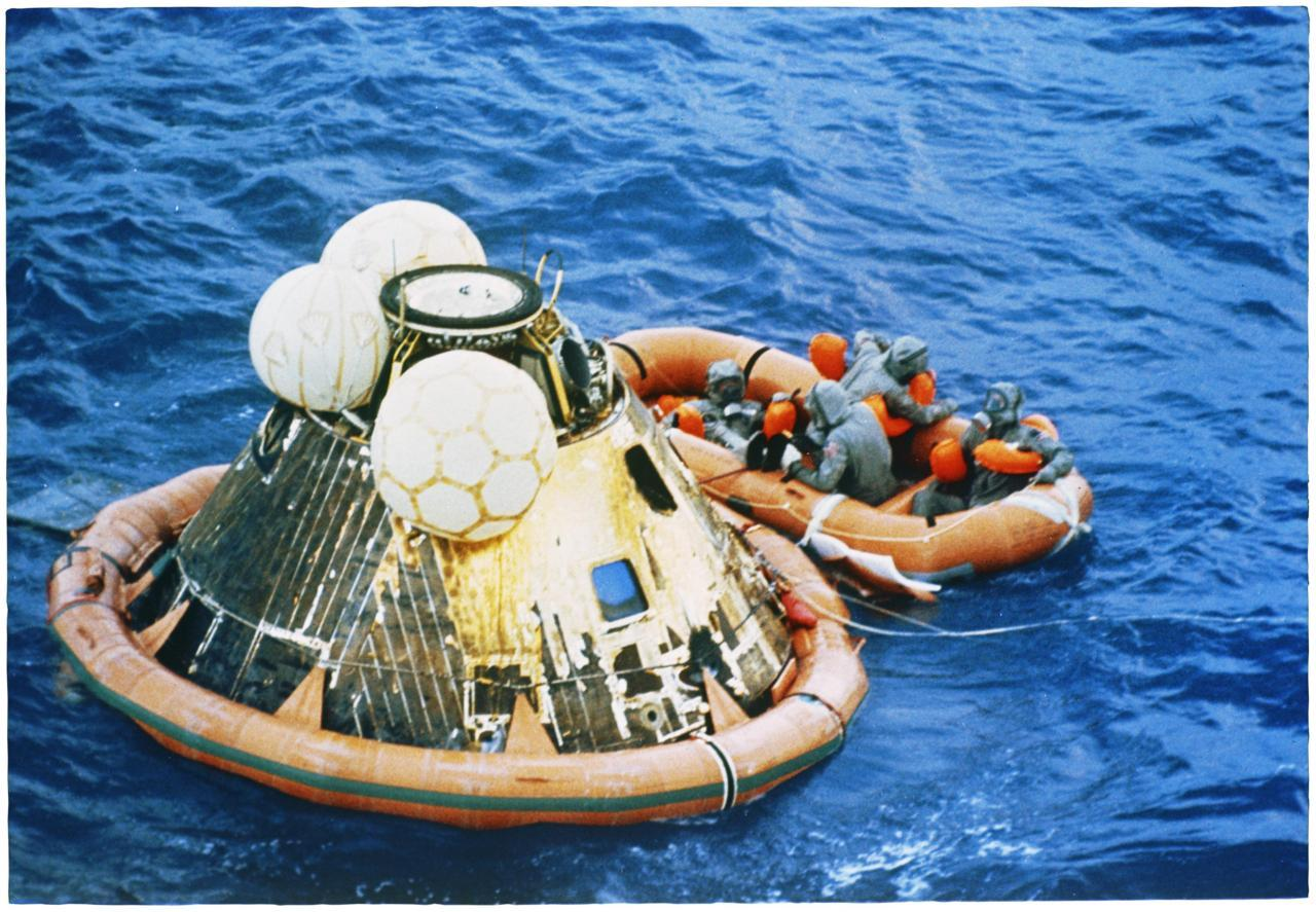 """Recovery of Astronauts,"" July 24, 1969; Records of the U.S. Information Agency Having spent 21 hours and 36 minutes on the moon, the Apollo 11 astronauts returned to Earth on July 24, 1969, and were recovered by the USS Hornet after splashing down in the Pacific Ocean."