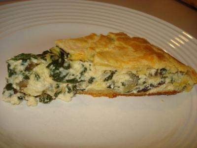 SWISS CHARD AND RICOTTA CROSTATA The best part about the summer months is my weekly trips to the Green City Market to pick up seasonal, local produce.  The greens have been so beautiful lately, particularly the chard.  Each week I go, I end up letting the guy talk me into buying two bunches even though I know it's more than I can eat.  It's a good deal at 2 huge bunches for $5, instead of 1 for $3.  Plus, it gives me an excuse to get creative and experiment in the kitchen… and I'll take whatever excuse I can get!  :) Food Network's website is my go-to when I'm searching for a recipe to use a particular ingredient because there is always such a variety of options.  I did a search for swiss chard and came across this recipe from Anne Burrell for a crostata.  I almost skipped passed it because I was a little intimidated with the whole making the crust process, but the rave reviews had me sold.  It didn't take me that long to prepare and the result is SO deliciously worth it!  A slice of this crostata made for the perfect thing to bring to the office for lunch!! INGREDIENTSCrust:2 c. all-purpose flour1 c. grated Parmesan½ c. mascarponePinch kosher saltPinch cayenne pepper1 stick cold butter, cut into pea-sized pieces2 eggs Filling:Extra-virgin olive oil2 cloves garlic, smashedPinch crushed red pepper flakes1 bunch Swiss Chard, stems removed cut into 1/4-inch lengths, leaves cut into 1-inch lengths2 leeks, tough green tops removed, cut in 1/2 lengthwise and then cut crosswise into 1/4-inch lengths2-3 T. waterKosher salt2 c. fresh ricotta1 c. grated Parmesan2 eggsPinch cayenne pepperEgg wash: 1 egg beaten with 2 tablespoons water DIRECTIONSCrust:Combine the flour, Parmesan, mascarpone, salt, cayenne and butter in the bowl of a food processor and pulse until it looks very dry and crumbly.  Add the eggs and pulse until the mixture forms a ball.  Remove the dough from the food processor and refrigerate for at least 30 minutes. Filling:Coat a large sauté pan generously with olive oil.  Add the garlic and crushed red pepper and bring the pan to a medium heat.   When the garlic has become golden brown and is very aromatic remove it and discard.  Add the Swiss chard stems, leeks, and 2 to 3 tablespoons of water and season with salt.   When the water has evaporated and the stems and leeks are soft, add the leaves.   Season the leaves with salt and sauté until they are very soft and wilted.  Remove from the heat and allow the Swiss chard to cool. In a large bowl combine the ricotta, Parmesan, eggs, cayenne, and the Swiss chard mixture.  Mix to thoroughly combine.  Taste and adjust the seasoning, if needed.  Set aside.  Preheat the oven to 375 degrees F. To assemble:Remove the dough from the refrigerator and let warm up for about 10 to 15 minutes, this will make it really much easier to roll out. Dust a large clean work surface with flour and roll the dough into a large circle about 1/4 to 1/8-inch thick.  Transfer the dough to a large sheet tray lined with parchment paper.  Lay the dough out flat, don't worry about the overhang on the sides of the sheet tray.  Put the filling in a large circle in the center of the rolled out dough leaving a 3 to 4-inch border of dough along the outside edge.  Fold the dough up around the filling to make a free-form pie.   Brush the top of the dough with egg wash and bake in the preheated oven until the crust is firm, golden brown and shiny (about 45 to 50 minutes).   Remove from the oven and let cool for 10 to 15 minutes before slicing, this will allow it to up for easier slicing.  Serve hot or at room temperature.