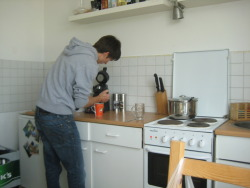 a photo of Milan making me coffee :D i really liked their kitchen!