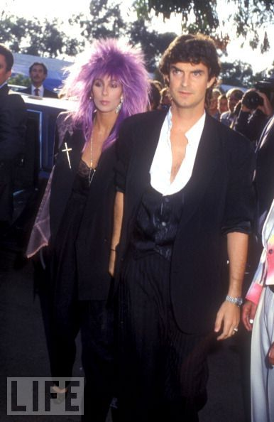 A Purple Fright wigged Cher and Josh Donen arrive at Madonna and Sean Penn's wedding on August 16, 1985 in Malibu, California.