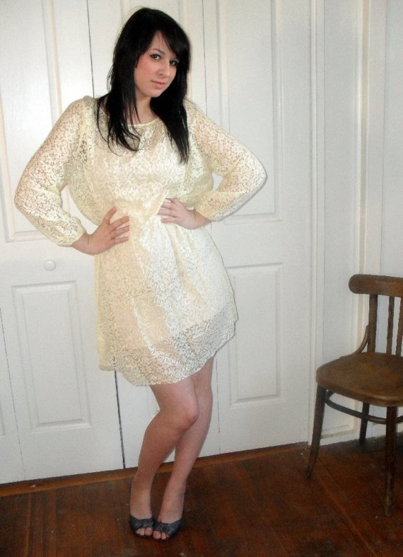 Vintage Yellow Lace Dress by Frankie & Plum | Let's Go Shopping! Well if I can't feature my own stuff in Let's Go Shopping, then what's the point of having this fabulous blog, right!? Haha! Laura, please don't kill me for putting this up. This is one of my favourite pieces in the shop. I found it at a local Salvos along with the boots featured in the shop, and was like - gold! It was part of an op-shop-hop that I did with my cousin Collette. Doesn't Laura look adorable in it? And for those wondering what my house looks like, this picture is taken in my dining room. Those french doors lead into my second bedroom. From the dining room. No, I don't know why they are there. But that's beside the point. Buy this dress and channel your inner Goldie Hawn (for some reason I think of Goldie Hawn when I see this. Like something she would have worn in the sixties while sporting a giant beehive and glitter on her eyes?)
