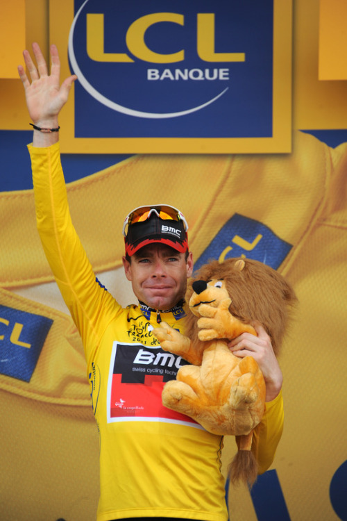 Tour de France 2011 | Stage 20 Barring any calamities, the winner of this year's Tour: Cadel Evans. (via Yellow Jersey Of Overall Leader, Australia's Cadel Evans, Waves - Yahoo! Sports Photos)