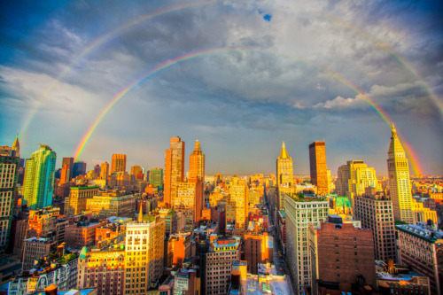 tallwhitney:  laughingsquid:  Double Rainbow Over Manhattan  Pretty!  It looks like the emerald city… Also, I'm going in a couple of weeks for my bday weekend!