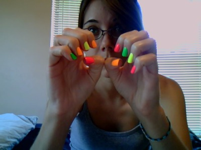 Neon skittles! Base coat: Gelous Advanced Nail Gel Coat White base: Sinful Colors - Snow Me White Pink: Sinful Colors - Pink Yellow: Sinful Colors - Neon Melon Green: China Glaze - Kiwi  Cool-Ada Orange: Chine Glaze - Sun Worshipper Top Coat: INM Out The Door