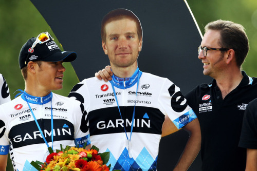 Jonathan Vaughters (R) manager of Garmin Cervelo team poses with a cardbord cutout of injured rider David Zabriskie (via Cycling - Photo Gallery - Yahoo! Sports) Here's a better view of Dave Z.