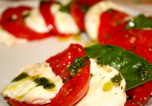 Italy in a dish. Tomatoes, mozzarella cheese, basil and pesto sauce. Delicious.