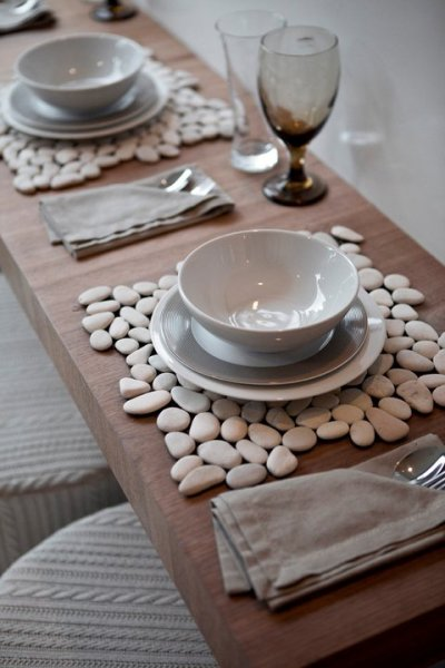 Pebble tiles are available at most hardware stores.  Use as a placemat! Via: Pinterest.