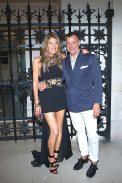 Anna Dello Russo & George Cortina          I absolutely love these two. They are always together and they always look great.