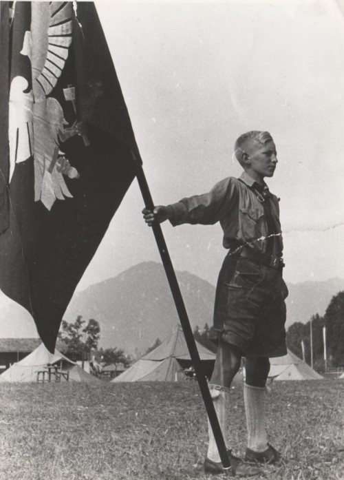 forthosewhofell:  Boy of the Hitler Youth with a flag.