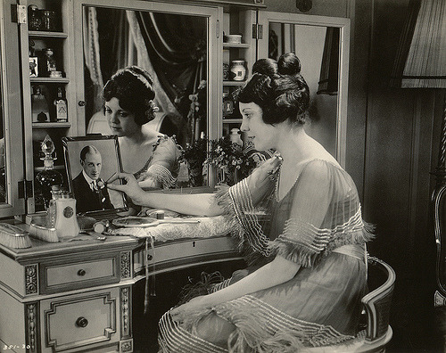 theloudestvoice:  Lila Lee gazing at a photo of Conrad Nagel in Midsummer Madness, 1920 (via MVTT HVLL)