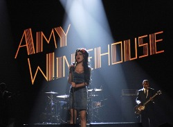 "rollingstone:  Since news of Amy Winehouse's death broke Saturday, musicians, celebrities and fans around the world have been sharing their appreciation for the soul singer whose life was cut much too short. Longtime friend Russell Brand posted a personal essay to the singer on his website, and fellow Brit-crooner Adele wrote on her blog, ""Amy paved the way for artists like me and made people excited about British music again whilst being fearlessly hilarious and blase about the whole thing. I don't think she ever realized just how brilliant she was and how important she is, but that just makes her even more charming."" But some of the most poignant tributes have come from her fans, who have been leaving flowers, candles, poems and more outside her house in North London. We spoke to some of them today, like Simon, a Camden Town resident of over 30 years who remembered Winehouse from her days working at a local launderette and her performances at the Jazz Cafe.""It doesn't make it any less bad that she was damaged, that she was a woman in pain,"" he said. ""They'll remember her as a great Londoner and a great artist, one of the greatest voices of the last 50 years."""