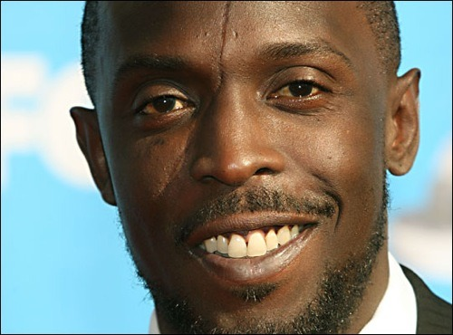 "thedailywhat:  Casting News of the Day: Omar Coming: Michael K. Williams — best known as Omar Little from HBO's The Wire and Chalky White from HBO's Boardwalk Empire — will play a badass biology professor in the last three episode of Community's upcoming season, according to showrunner Dan Harmon. ""I want to add a layer of intensity to Community,"" Harman explained at the show's Comic-Con panel. ""f the show's ever been too weird to attract new viewers, you can add water to have less flavor and hope it threatens less people, or you can threaten the hell out of everyone with the kind of intensity and flavor that people will get tired of pretending isn't awesome."" [warmingglow / thd.]  SHUT THE FRONT DOOR. Omar on Community?! My life is complete."