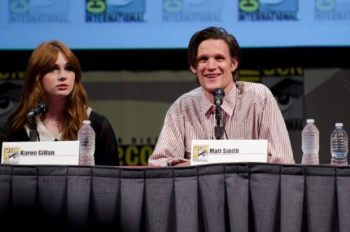 "thetardis:  doctorwho:  'Doctor Who' Panel Ends a Jam-Packed Comic-Con Weekend   It all started with the chanting. Then the clapping and stomping. Next the sonic screwdrivers were raised high into the air, their squiggly squeaks resounding throughout Hall H, which was filled to its 6,500-seat capacity. In the back of the room, you could see young Nick Pickett, founder and president of his Doctor Who club at Marshall Middle School in San Diego, standing proudly alongside the more than six-feet tall orange Dalek that his schoolmates helped to build. Costumes included TARDISes of all colors, a gallery of Doctors since 1963, and more. It was a gigantic party, pep rally, and media event all wrapped into one. Stars Matt Smith and Karen Gillan were joined by writer Toby Whithouse and executive producers Piers Wenger and Beth Willis for the Doctor Who panel at San Diego Comic-Con. BBC America unveiled a brand-new trailer, which went over gangbusters, as well as an premiere date for the fall season (August 27) and a sneak peek at Toby's upcoming episode, ""The God Complex."" (Which looks amazingly wacky, with hotel interiors, fish bowls, hair dryers, and people being tied up.)  read the rest over at Anglophenia  People being tied up?  Yup.  People being tied up."