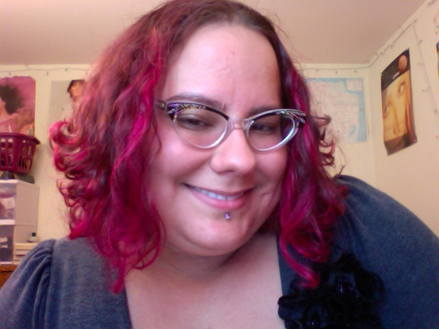 "New labret jewelry & newly Muppet Pink hair. For no reason other than vanity, really.In other news: + My best friend from childhood — like, seriously, we met when I was in the 5th grade & grew up 3 blocks away from each other in the Ingleside/Lakeview — got married this weekend. I did a reading at the wedding, and I apparently made many people cry. Hearing that was really awesome, sweet, and touching. I quoted from my favorite poem about love — Allen Ginsberg's ""Song.""+ My own feelings about mawwiage & matwimony are complex. I used to be very RAWR RAWR anti-assimilationist about marriage — both gay marriage and straight marriage — in my teens & early twenties. I am less so now. I hate to sound trite &/or ageist, but I feel like age has kinda mellowed me out about this sort of thing. Basically, I think that people should be able to marry whomever they damn well please, but I could also care less about the state approving my or my friend's relationships. I get why queer people fight for marriage as a legal right — it isn't always just about assimilation, it is also about things like being able to have custody of your kids and visiting your partner in the hospital when they are sick. BUT I really wish that the energy/momentum that people pour into ""marriage equality"" was also going into things like, oh, housing homeless queer & trans youth, fighting for universal health care, protecting immigrants & undocumented folks & people working in street economies, etc, etc, etc. I just feel like, at the end of the day, esp. as a queer non-monogamous pervert who does my relationships & sex life in fairly non-standard ways, marriage equality is not really my struggle.+ See also, the ways that couples — all kinds of couples — get privileged over ""single"" people and people in more non-traditional relationships bugs the hell outta me.+ But anyway: When I think of weddings NOT as the state barging into my life/my friend's lives, but as big awesome parties & rituals to celebrate love & passion & life, I like them a whole lot. I guess I am a romantic in that way?+ My point being, the wedding was sweet, and I feel very lucky to still be very close with my childhood best friend. + Also? The cake was awesome. Just sayin'."