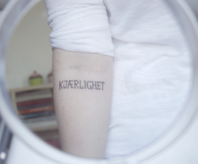 This tattoo belonged to our beloved Synne, who passed away July 22. Kjærlighet means love in Norwegian. We miss you a lot.