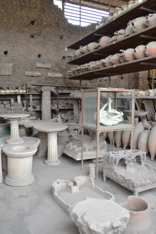 On the way back from southern Italy on Sunday, we stopped in Pompeii. We split into smaller groups and had tours of the ancient city. The city was very interesting and I was amazed how the archeologist ware able to get so much information about the people from what they found. I didn't realize this was the city covered that volcanic ash buried the city in 5 meters of ash. When the city was rediscovered, cavities were found where people had died. These cavities were filled with plaster before being dug up and the last expression of the peoples faces were captured. On the tour of the city, we saw different remains of stores (some were fast food where the bar was set up facing the street and others where black smiths where the ovens were still intact) and different types of houses (the poor and the luxurious wealthy houses with multiple rooms and decorative tiles). The streets had sidewalks and occasionally there were large stones that connect the two sides, this was because the city streets were used as their sewage system. Also, track could be seen from where carts were drawn. The main attraction of Pompeii is the brothel. Prostitution was legal and very publicized in the city. Around the city, there were many penises that pointed the direction of the brothel. In the brothel, there were two floors and on the outside of each door there were different images of positions that men could choose when they went in, very descriptive and vivid :/Returning home on Sunday, a group of us went to the festival by the river for Mexican food!
