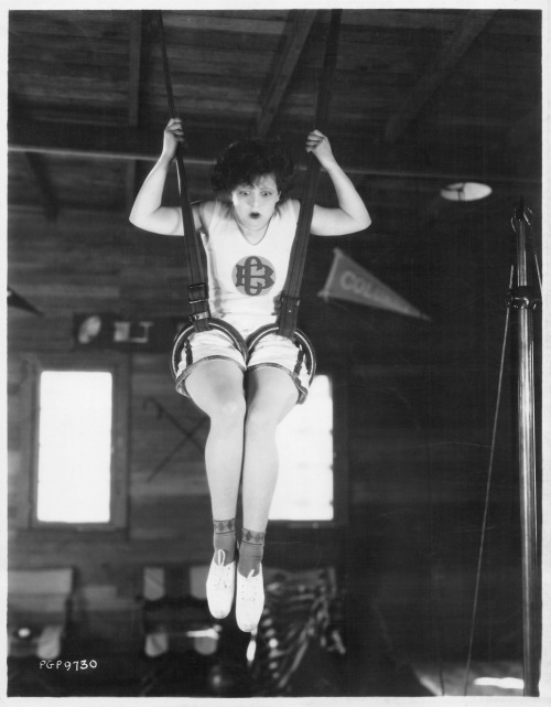 clarabowarchive:  Clara Bow original linen-backed photo by Irving Klaw. Typed on reverse:  WHOOP-EE-E! Clara Bow, Paramount star enjoys a bit of exercise while between pictures. This picture was taken in her own gymnasium.  Stamped on reverse:  PLEASE CREDIT  An IRVING KLAW PHOTO 212 East 14th Street New York 3. N.Y.