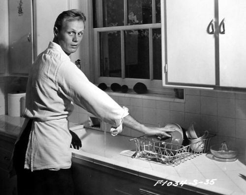 Richard Widmark washes dishes - c. 1940s